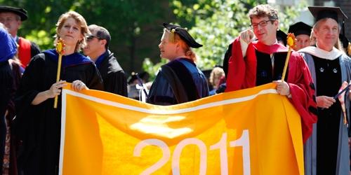 Class deans hold the 2011 class banner