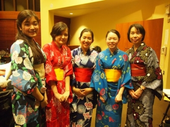 students posing in traditional outfits