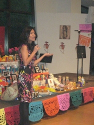 person speaking in front of traditional table