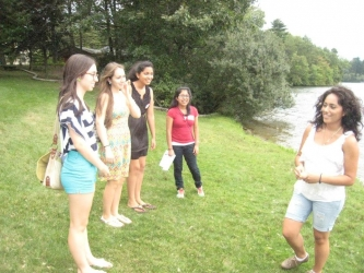 students talking by lake waban