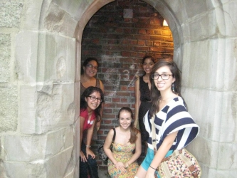 students posing by the 9 3/4 staircase of green hall