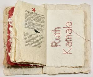 Art book with cross stitch design
