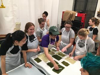 Students sample paper made with phragmite fiber
