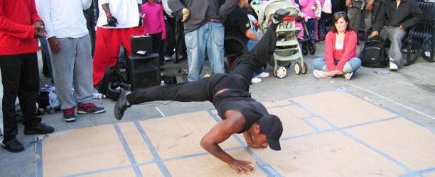 guy breakdancing on cardboard