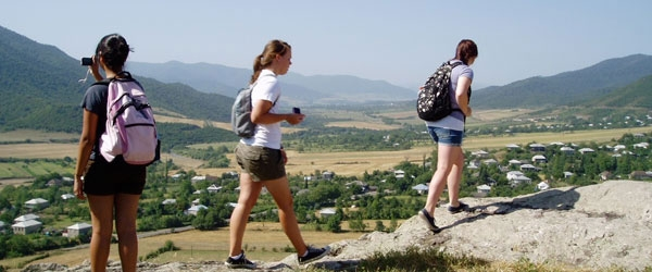 students hiking to dig site
