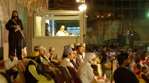 Tahir ul Qadri behind bullet-proof glass.