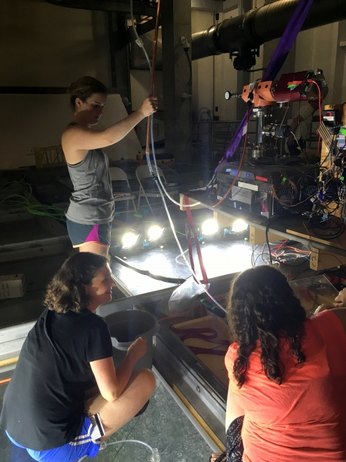 Rachel Stanley with students Callie Krevanko and Helene Alt and a noble gas quadrupole mass spectrometer