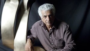 A photo of influential Iranian artist Parviz Tanavoli