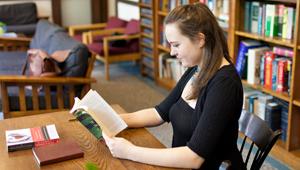 Maggie Zebracka reading in the library